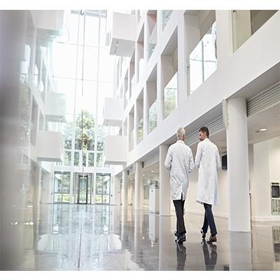 two people walking on floor