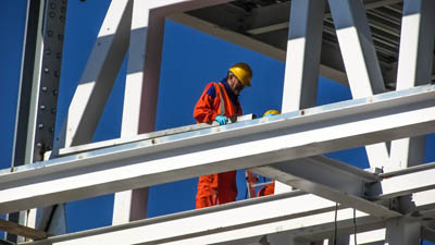 Aciron case study construction worker on metal scaffolding