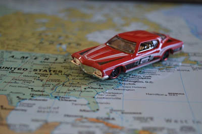 Aciron case study red toy car on map