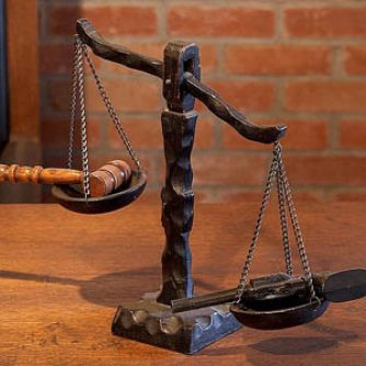 Case Study scale measuring a gun and a gavel