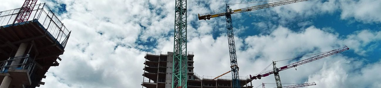 Aciron construction crane with blue sky