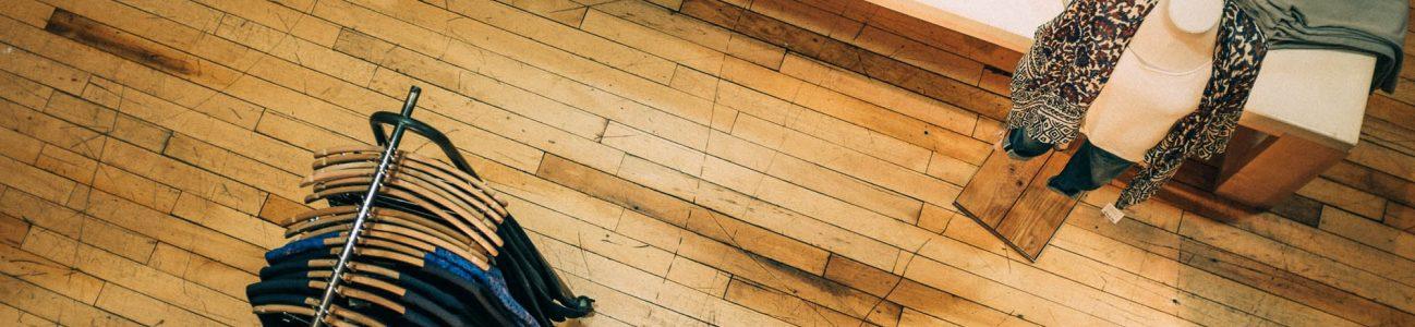 Aciron top view of clothing store wooden floor