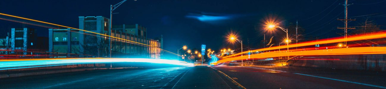 Aciron case study dark highway with red and blue lights
